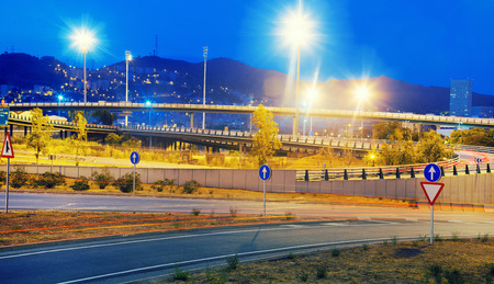 Light trails on Illuminated city motorway in evening   Stock Photo