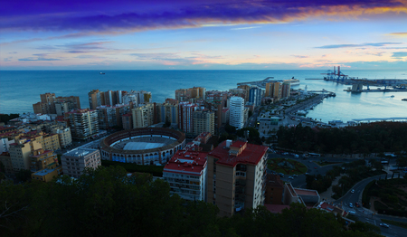 spanish bull: Sunrise view of Malaga with Port and Placa de Torros from castle.   Spain