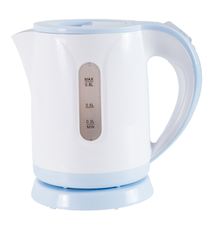 Small plastic electric kettle of light color in close-up