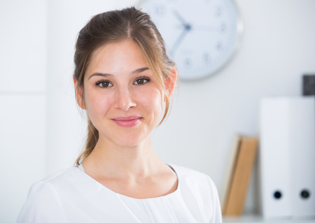 Close up portrait of smiling businesswoman at work office