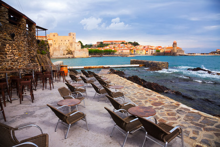 vermeil: Panorama of picturesque colorful Collioure through bay from restaurant in spring day