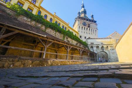 View of clock tower from fortress square in center of Sighisoara, Transylvania, Romania Editorial