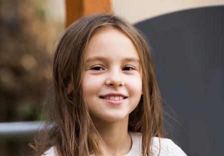 Portrait of happy girl in autumn outdoors Archivio Fotografico