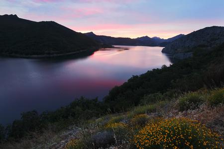 mountains lake in summer sunrise.  Barrios de Luna reservoir.  Spain