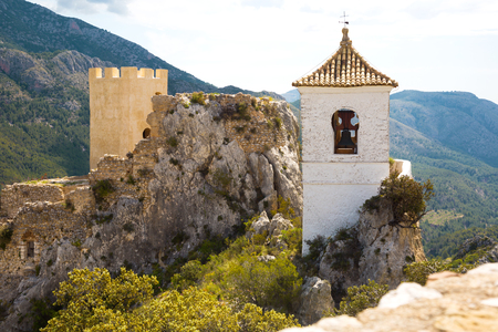 Old building of Guadalest castle surrounded by forest and mountains