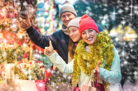 Cheerful portrait ordinary parents with teen girl in market