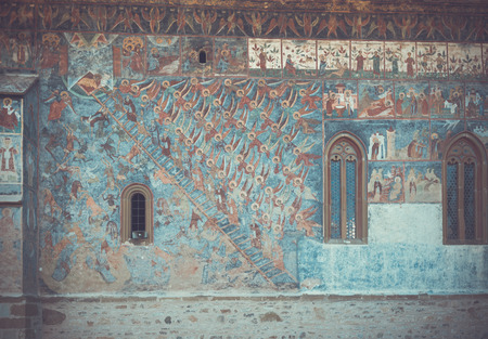 Church of Sucevita Monastery and frescoes on outer wall of it on Bucovina in Romania. Imagens - 90817194