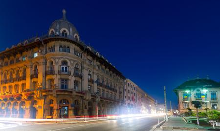 Blur busy traffic on illuminated Craiova streets at night