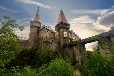 Corvin Castle is on the green mountain of Romania.