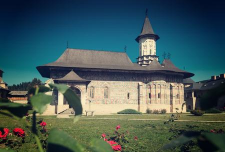 View of painted church in monastic complex in romanian village Sucevita, Romania
