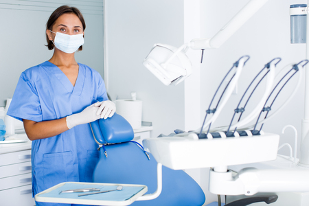 Girl stomatologist is readying meet next client in dentist offic