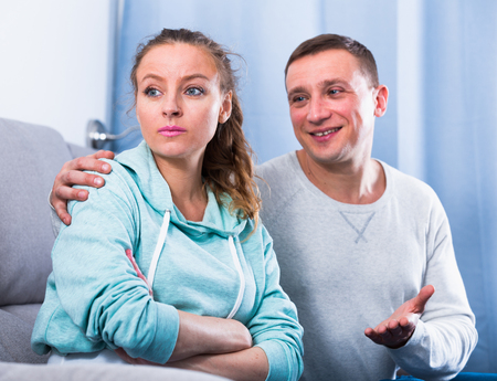 Middle-aged husband and wife arguing with each other at home Stock Photo