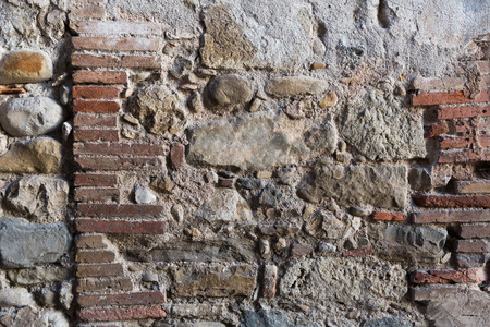 Old damaged stone wall surface texture