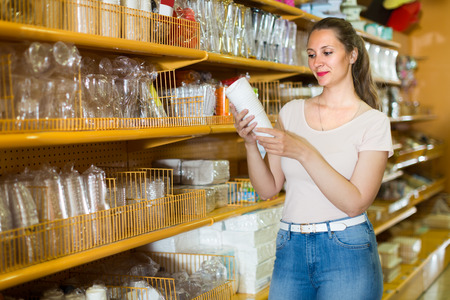 Girl is holding paper cups that she want to buy for the upcoming party.  Stock Photo