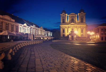 Twilight view of Roman Catholic Dome on Unirii Square, Timisoara, Romania Stock Photo