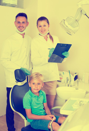 Young client is satisfied after visiting of dental office.