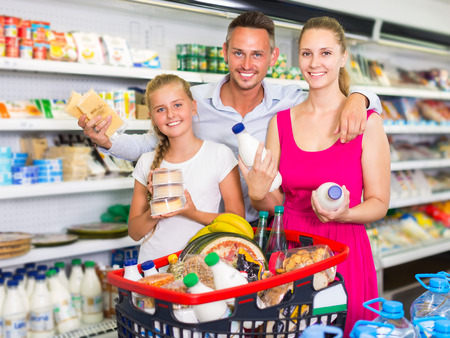 Portrait of customers which is selecting milk in supermarket. Zdjęcie Seryjne