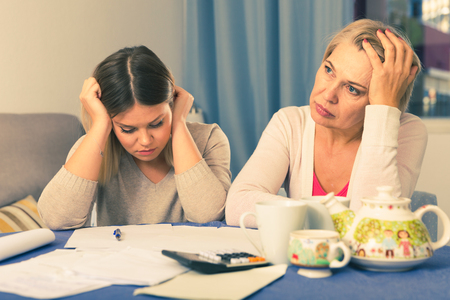 Mother and her adult daughter took on head from bad financial condition and lot of debts