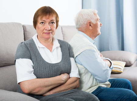 Aged husband and wife arguing with each other at home