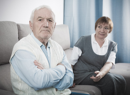 Mature husband and wife quarrelling with each other at home Stock Photo