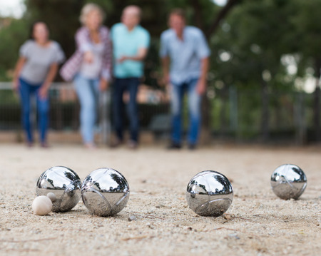Portrait of friendly people playing petanque at leisure