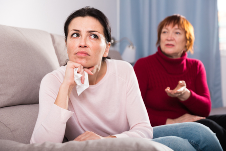 Portrait upset adult women looking away after conflict at home interior Stock Photo