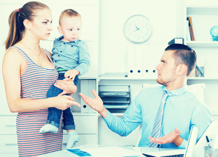 Portrait of frowning manager of insurance company with angry female