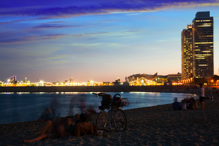 Famous Barceloneta beach on Mediterranean in Barcelona in evening dusk