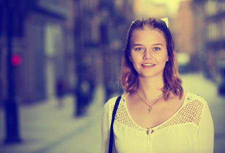 Portrait of young positive female in the modern city center Stok Fotoğraf