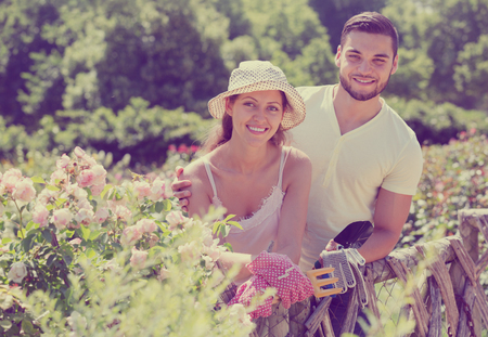 Young family is engaged in gardening Stock Photo