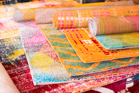 Assortment of colour carpets selling in the store home goods