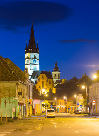Twilight image with Sibiu streets and Cathedral of Saint Mary, Romania