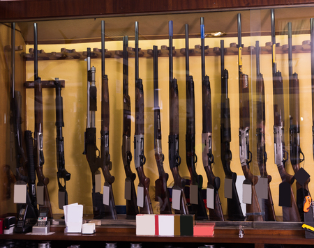 Gun store interior with different rifles on showcase