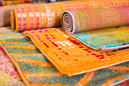 Various colorful wool rugs for sale at store, no people Stockfoto