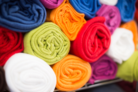 image of different cotton colour towels in the textile shop
