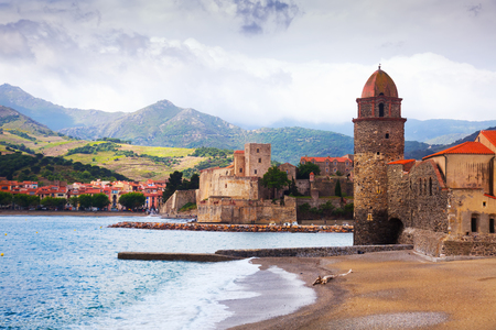 Church of Notre-Dame de Anges and promenade in picturesque harbor of Collioure