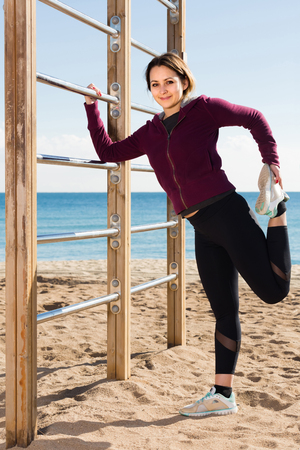 Persistent adult female training  at sea beach   Stock Photo