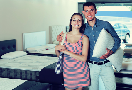 Married couple decided to buy a mattress for a bedroom in the store
