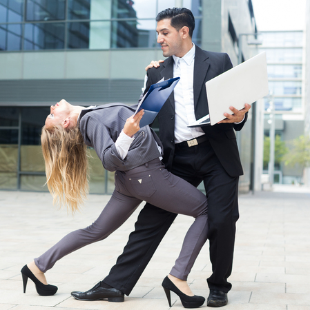 Couple of managers are dancing near office in time break. Stock Photo