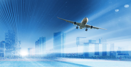 Airplane hovering highly in the sky over skyscrapers Stockfoto