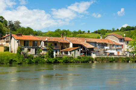 Houses near the hill on the Salat river in France.