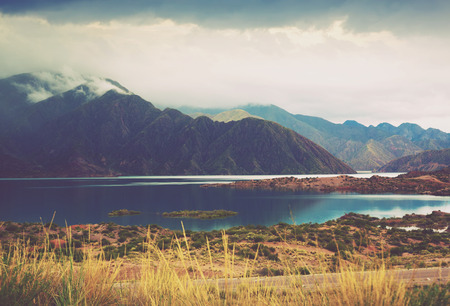 View of lake near Potrerillos and Andes mountains in summer day, Mendoza province, Andes, Argentina