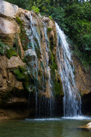 Waterfall in Catalonia surrounded by beautiful forests and valleys