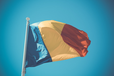 Romanian flag is national symbol of country. Banco de Imagens