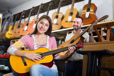ordinary customers in music instruments shop