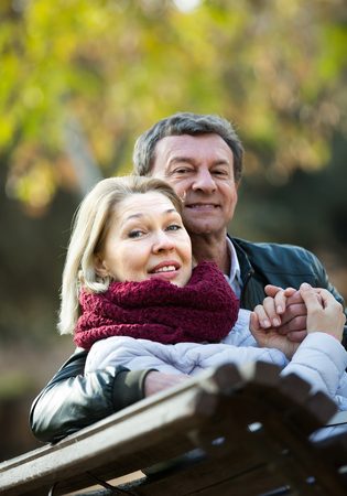 Portrait of happy senior couple enjoying spring day  in park . Focus on woman