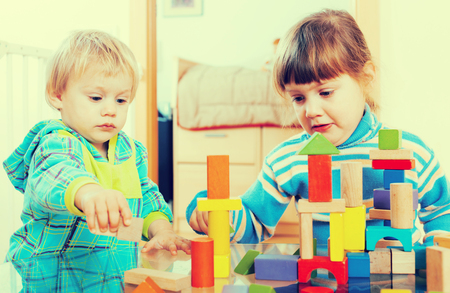Two serious children  in home interior Stock Photo
