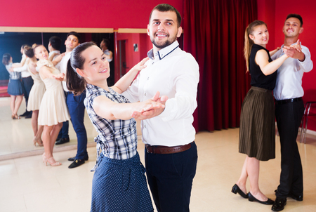 Young people dancing together slow ballroom dances in pairs Stock Photo