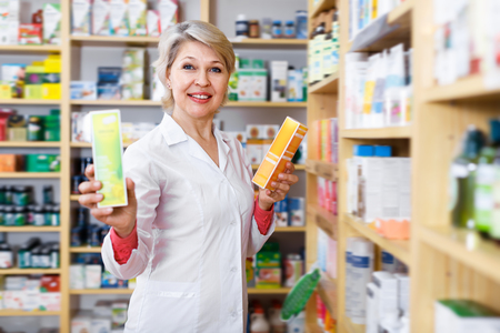 Ordinary seller recommending skin care products in specialized shop