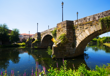 old  bridge at Monforte de Lemos in summer day. Galicia, Spain